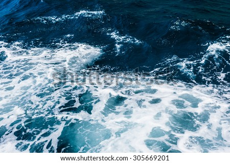 detail of the turbulent deep ocean water surface - stock photo