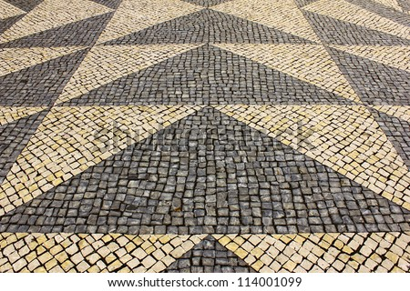 Detail of the typical portuguese pavement at Lisbon, Portugal - stock photo