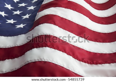 Detail of the United States of America flag waving in the wind.