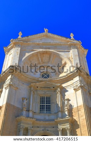 Detail of the upper facade with Baroque architecture of the Cadiz Cathedral in Cadiz, Andalusia, Spain - stock photo