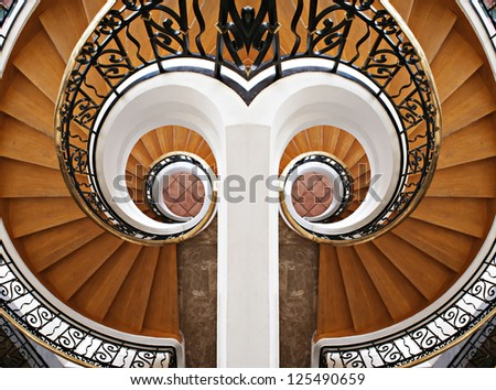 Detail of the wood spiral staircase. Hotel, stairs, stairway, step - stock photo
