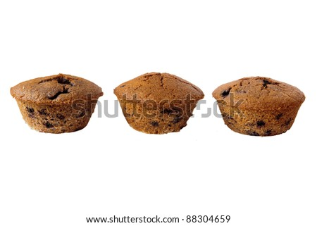 Detail of three gluten free muffins with blueberries isolated on white background