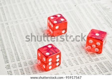 detail of three red dice on the financial newspaper