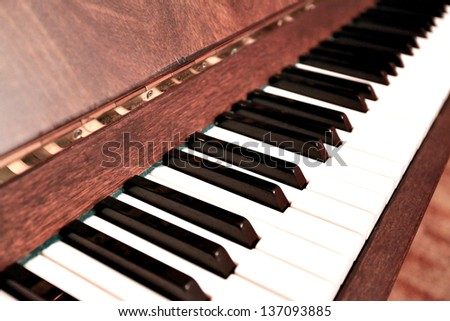 Detail of traditional black and white keys on music keyboard - selective focus - stock photo