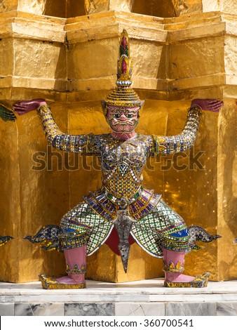 Detail of traditional mosaic tile Demon Guardian statue. Grand Palace, Bangkok. Thailand. - stock photo