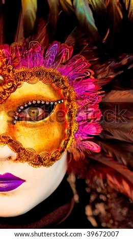 Detail of traditional Venice mask with colorful decoration - stock photo