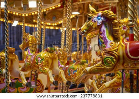 Detail of traditional Victorian carousel in the courtyard of the Natural History Museum. December 11, 2014 in London.  - stock photo