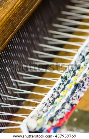 Detail of traditional weaving loom and thread - stock photo