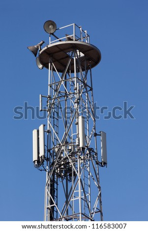 Detail of transmitter tower against a clear blue sky.