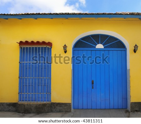 Detail of tropical vintage house facade in yellow and blue at trinidad town, cuba - stock photo