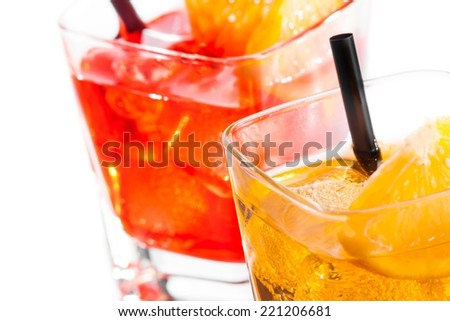 detail of two cocktail with orange slice on top isolated on white background - stock photo