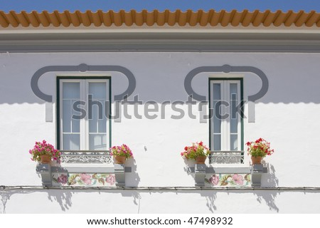 Detail of two windows on a white wall background at algarve villa, south of Portugal - stock photo