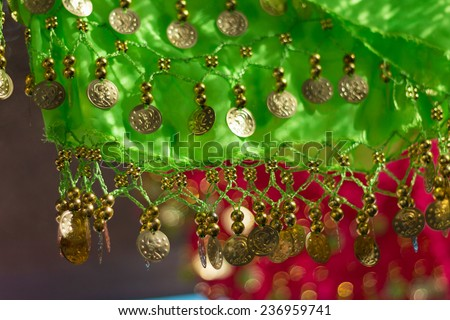 Detail of typical gipsy colorful clothes. Shallow depth of field. - stock photo