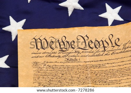 Detail of U.S. Constitution with stars and blue field background - stock photo