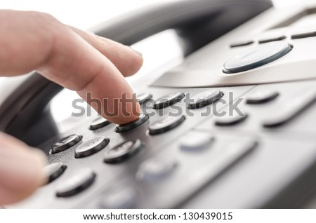 Detail of using a telephone keypad. Shallow dof. - stock photo