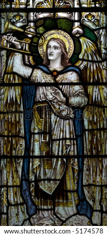 detail of victorian stained glass church window in Fringford depicting a typical victorian angel with a horn or trumpet in his hands - stock photo