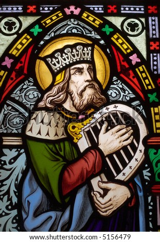 detail of victorian stained glass church window in Fringford depicting King David, the author fo the psalms in the Old testament with a hand harp - stock photo