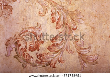 Detail of vintage beige shabby chic wallpaper with vignette pattern and craquelure - stock photo