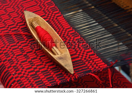 Detail of vintage belorussian weaving loom with wool close up - stock photo