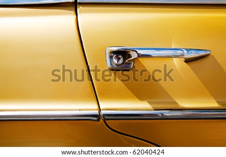 detail of vintage car door - stock photo