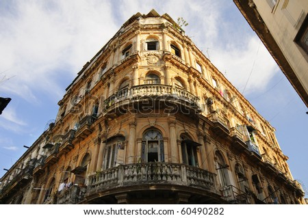 Detail of vintage facade in crumbling Havana building - stock photo