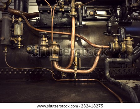 Detail of vintage machine with pipes and valves - stock photo