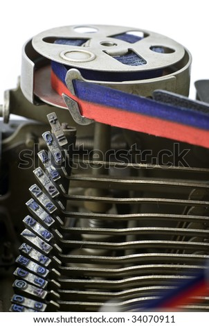 detail of vintage, mechanical typewriter showing type bed and ribbon spool - stock photo