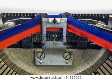 detail of vintage, mechanical typewriter with paper in carriage; space to enter your message in a 'typewriter' font - stock photo