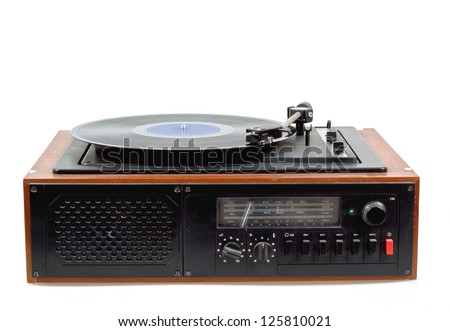 Detail of vintage radio gramophone player with vinyl - stock photo