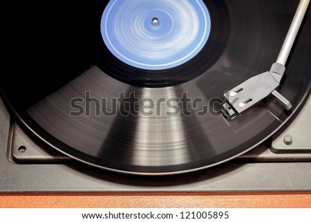 Detail of vintage record player with spinning vinyl. Motion blur image. - stock photo