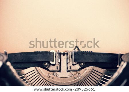Detail of vintage typewriter with blank paper for text - stock photo
