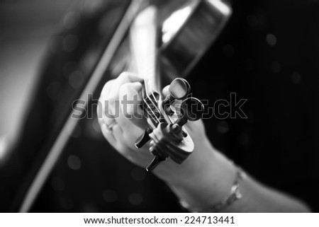Detail of violin being played by a musician. - stock photo