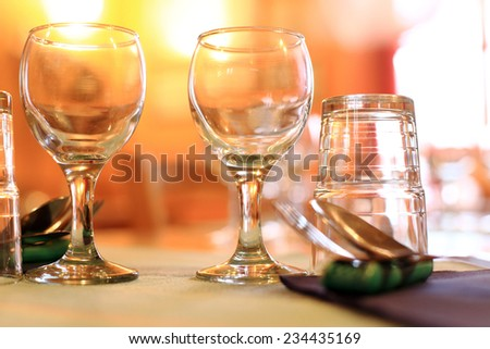 detail of warm restaurant table - stock photo