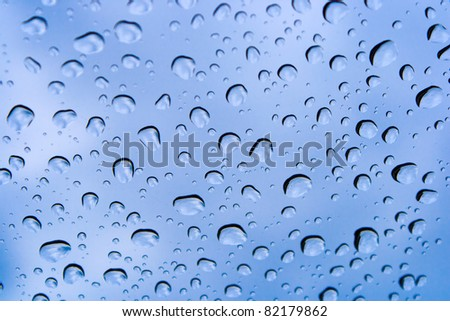 Detail of water drops on the car glass - stock photo