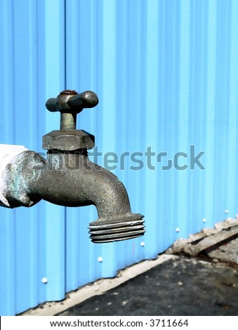 Detail of water spigot - stock photo