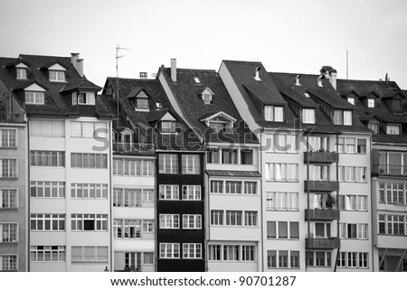 Detail of waterfront houses along the Rhine River in Basel, Switzerland (black and white picture) - stock photo