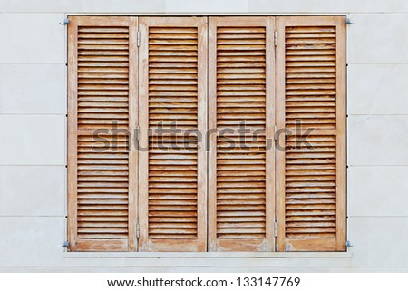 Detail of weathered brown shutters of a spanish house - stock photo