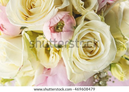 detail of wedding bouquet on pink background, pink and ivory bouquet, holiday celebration