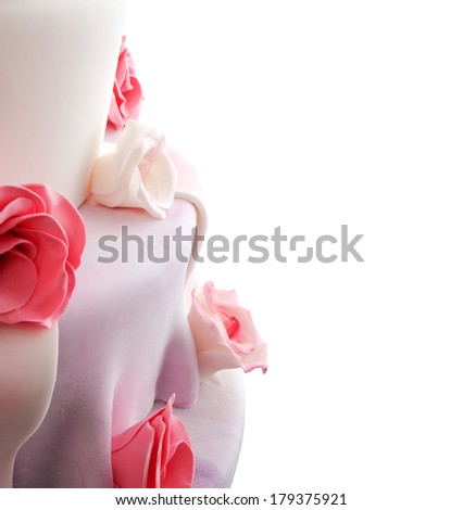 Detail of wedding cake with red and white roses (space for your logo or text - stock photo