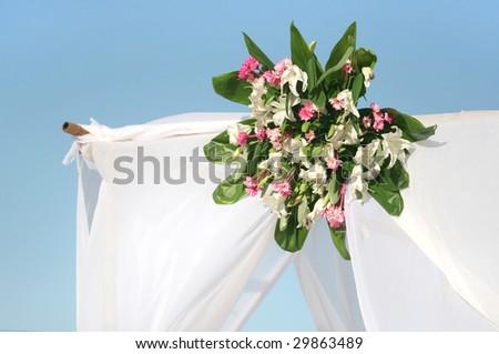 Detail of wedding gazebo on a tropical sand beach - stock photo