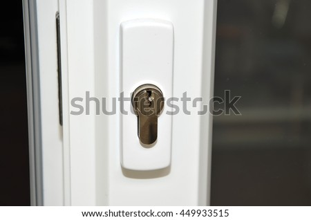 detail of white plastic sliding doors lock photography