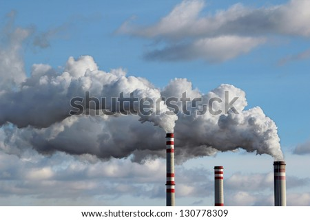 detail of white smoke polluted sky - stock photo