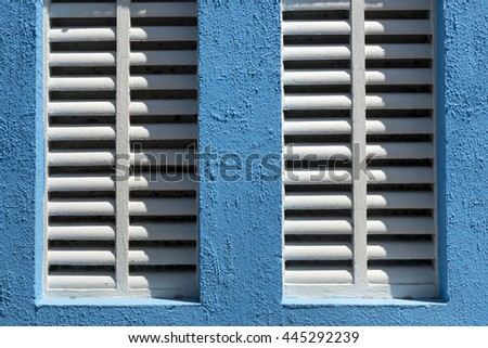 Detail of window with white sun shutter - stock photo