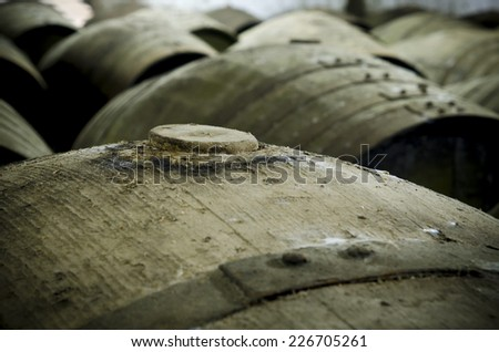 Detail of wine barrel, cap in the foreground - stock photo