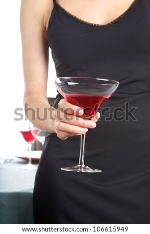detail of woman hand with cocktail glass red beverage - stock photo
