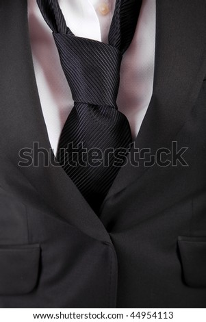 Detail of woman's suit and tie - stock photo