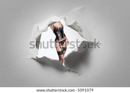 detail of woman seen through a hole in a blackboard - stock photo