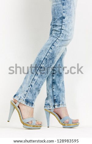 detail of woman wearing denim summer shoes