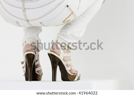 detail of woman wearing summer shoes - stock photo