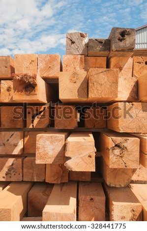 Detail of wood blocks stacked at lumber mill in Ontario, Canada